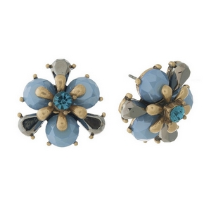 Burnished gold tone, blue flower shaped, stud earrings with a blue center rhinestone. Approximately 20mm in diameter.