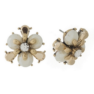 Burnished gold tone, white flower shaped, stud earrings with a clear center rhinestone. Approximately 20mm in diameter.