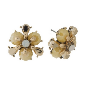 Burnished gold tone, yellow flower shaped, stud earrings with a milky center rhinestone. Approximately 20mm in diameter.