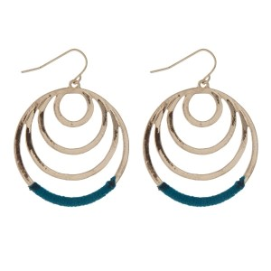 """Gold tone fishhook earrings with cascading circles and teal thread. Approximately 1.25"""" in length."""