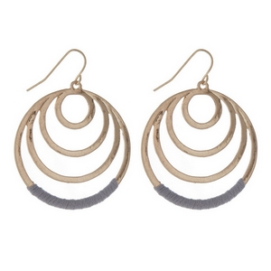 """Gold tone fishhook earrings with cascading circles and gray thread. Approximately 1.25"""" in length."""