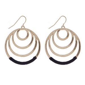 "Gold tone fishhook earrings with cascading circles and navy thread. Approximately 1.25"" in length."