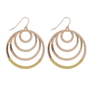 """Gold tone fishhook earrings with cascading circles and yellow thread. Approximately 1.25"""" in length."""