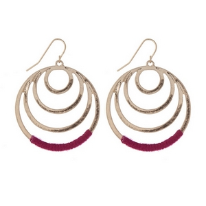 """Gold tone fishhook earrings with cascading circles and fuchsia thread. Approximately 1.25"""" in length."""