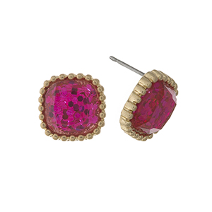 "Gold tone stud earrings with a pink glitter square shape. Approximately 1/2"" in length."