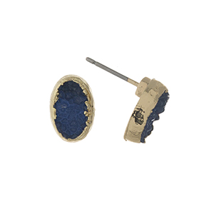 "Gold tone navy blue druzy stone stud earrings in an oval shape. Approximately 1/3"" in length."
