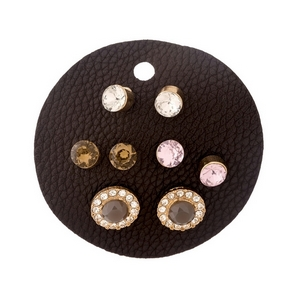 Four pair, gold tone earring set with assorted shades of pink and topaz rhinestones and clear pave accents.