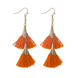 "Gold tone fishhook earrings with two neon orange tassels. Approximately 3"" in length."