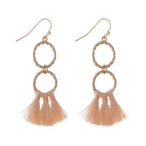 """Gold tone fishhook earrings with a two connecting circles and three small blush tassels. Approximately 2"""" in length."""