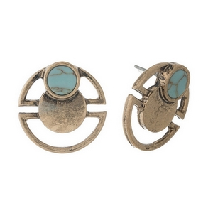 """Matte gold tone stud earrings with a turquoise stone accent. Approximately 3/4"""" in diameter."""