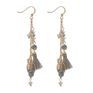 "Gold tone fishhook earrings displaying chain tassels with gray beads, labradorite stones, and gray tassels. Approximately 2.5"" in length."