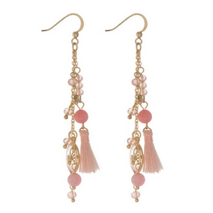 "Gold tone fishhook earrings displaying chain tassels with peach beads, cherry quartz stones, and pink tassels. Approximately 2.5"" in length."