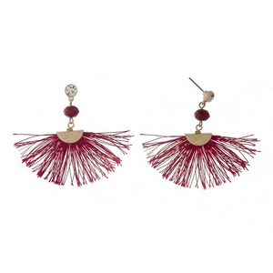 "Gold tone post style earrings with a red fan tassel, a burgundy bead and a clear rhinestone. Approximately 2"" in length."