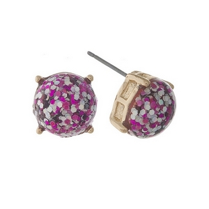 "Gold tone stud earrings with fuchsia glitter. Approximately 1/3"" in diameter."