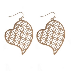 "Gold tone fishhook earrings with a gold tone filigree heart shape. Approximately 2"" in length."