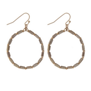 "Dainty gold tone fishhook earrings displaying an open circle with gray faceted beads. Approximately 1.25"" in diameter."