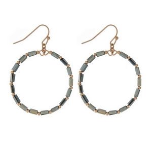 "Dainty gold tone fishhook earrings displaying an open circle with hematite faceted beads. Approximately 1.25"" in diameter."