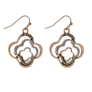 "Gold tone fishhook earrings displaying two tone clover shapes, stamped with ""lucky."" Approximately 1"" in length."