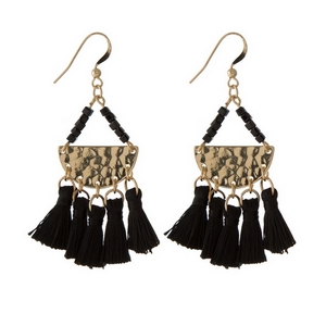 "Gold tone fishhook earrings featuring a hammered half circle with five, black fabric tassels. Approximately 2.5"" in length."