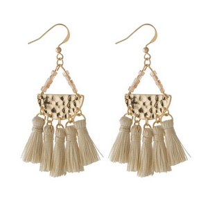 "Gold tone fishhook earrings featuring a hammered half circle with five, ivory fabric tassels. Approximately 2.5"" in length."