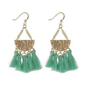 "Gold tone fishhook earrings featuring a hammered half circle with five, mint green fabric tassels. Approximately 2.5"" in length."