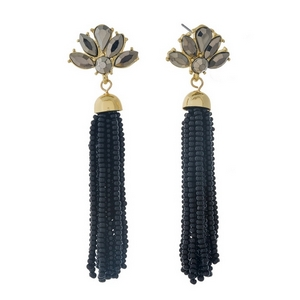 """Gold tone stud earrings featuring a black tassel and black rhinestones. Approximately 3"""" in length."""