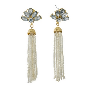 "Gold tone stud earrings featuring a clear tassel and clear rhinestones. Approximately 3"" in length."