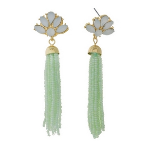 """Gold tone stud earrings featuring a mint green tassel and opal rhinestones. Approximately 3"""" in length."""