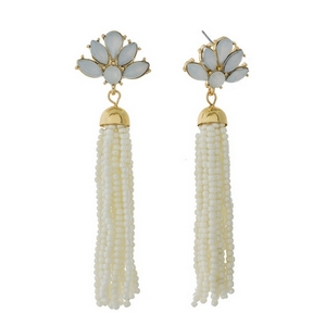"Gold tone stud earrings featuring a white tassel and opal rhinestones. Approximately 3"" in length."