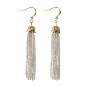 """Gold tone fishhook earrings featuring a clear beaded tassel. Approximately 3"""" in length."""