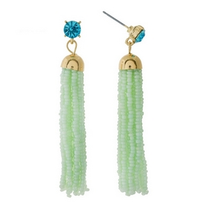 "Gold tone post style earrings featuring a mint green beaded tassel and rhinestone accent. Approximately 2.5"" in length."