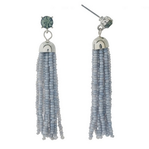 "Silver tone post style earrings featuring a gray beaded tassel and rhinestone accent. Approximately 2.5"" in length."