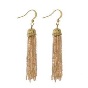 "Gold tone fishhook earrings featuring a topaz beaded tassel. Approximately 3"" in length."