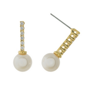 "Gold tone stud earrings featuring a clear rhinestone bar and a pearl bead. Approximately 1"" in length."