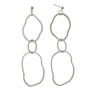"""Silver tone post style earrings featuring three hammered, interlocking rings. Approximately 3"""" in length."""