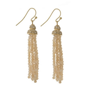 "Gold tone fishhook earrings featuring an ivory beaded tassel and clear rhinestones. Approximately 2.5"" in length."