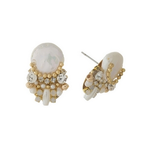 "Gold tone stud earrings featuring a flat freshwater pearl bead, clear and opal rhinestones. Approximately 3/4"" in length."