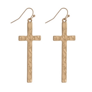 "Gold tone fishhook earrings featuring a hammered cross. Approximately 2"" in length."