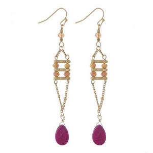 "Gold tone fishhook earrings with pink, topaz, and fuchsia stones and faceted beads. Approximately 3"" in length."