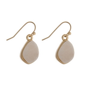 "Dainty gold tone fishhook earrings with a white faux druzy stone. Approximately 1/2"" in length."