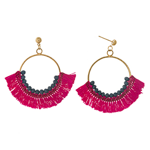 "Gold tone fishhook earrings with an open circle, navy blue beads, and pink fanned tassels. Approximately 2"" in length."