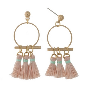 "Gold tone post earrings with an open circle and pale pink fabric tassels. Approximately 1.5"" in length."