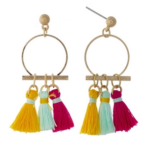 "Gold tone post earrings with an open circle and pink, yellow, and mint fabric tassels. Approximately 1.5"" in length."