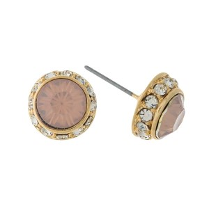 "Gold tone stud earrings with a pink opal rhinestone. Approximately 1/4"" in diameter."