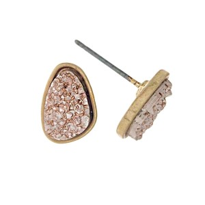 "Gold tone stud earrings with a rose gold faux druzy stone. Approximately 1/3"" in length."