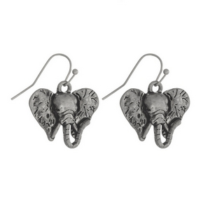 "Silver tone fishhook earrings with an elephant head. Approximately 3/4"" in length."