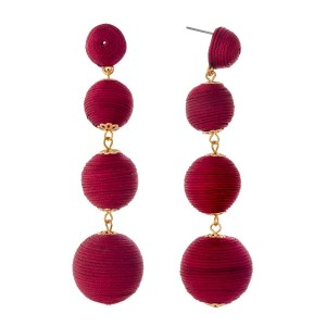 "Burgundy thread wrapped ball earrings with gold tone accents. Approximately 3.5"" in length."