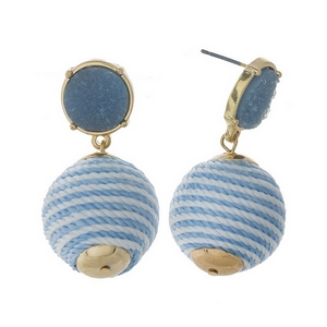 "Gold tone stud earrings with a light blue faux druzy stone and a white striped thread wrapped bead. Approximately 1.5"" in length."