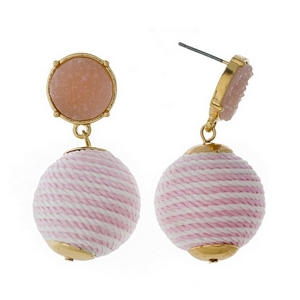 "Gold tone stud earrings with a light pink faux druzy stone and a white striped thread wrapped bead. Approximately 1.5"" in length."