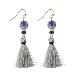 "Gold tone fishhook earrings with sodalite beads and a gray thread tassel. Approximately 2"" in length."